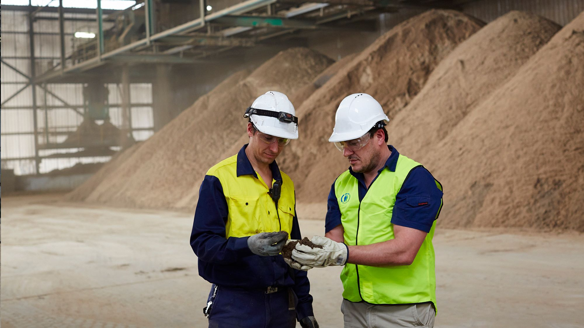 SUEZ employees examining compost at Neerabup ARRT facility