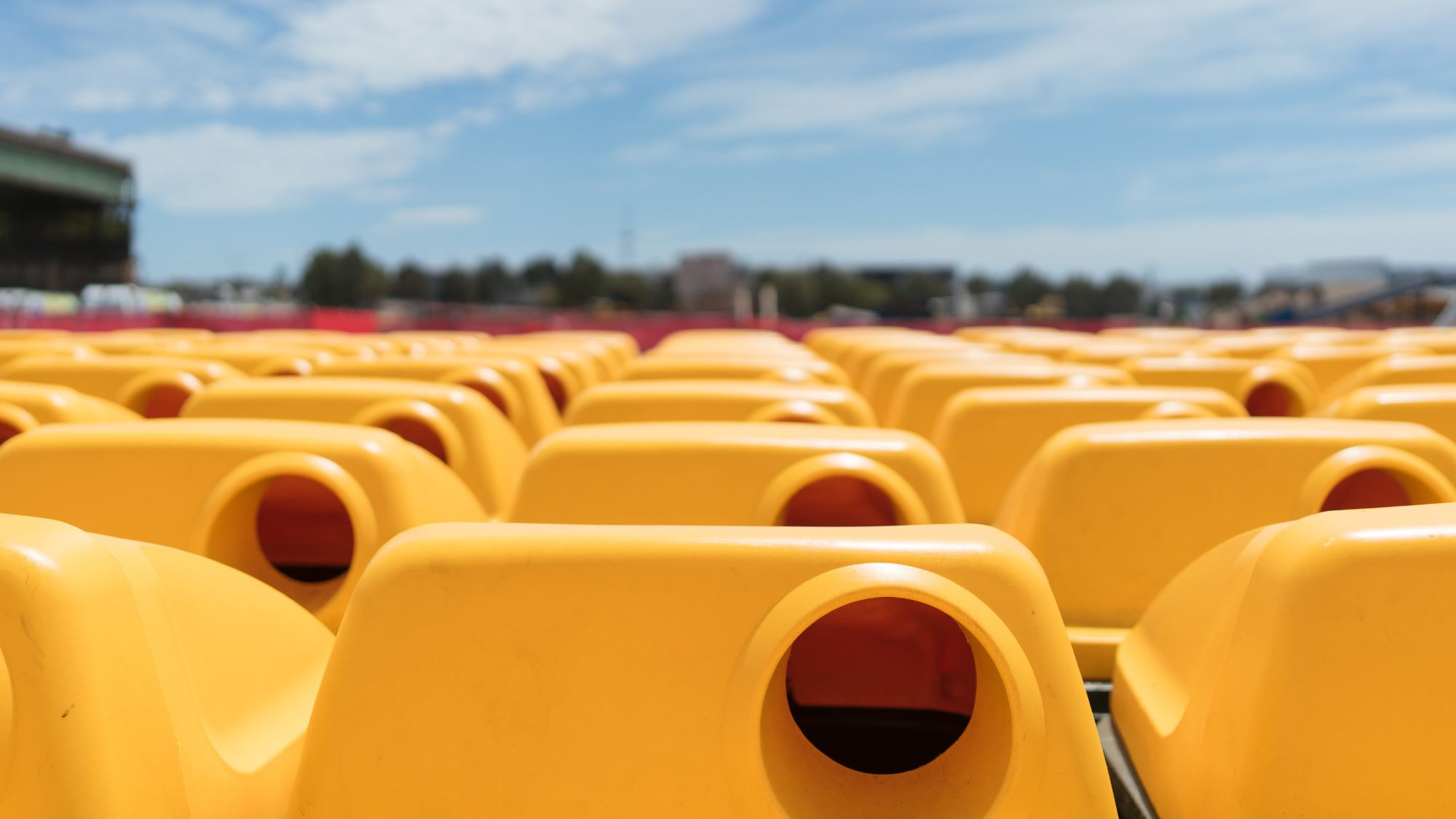 SUEZ bins and containers header image. Image showing close up of rows of yellow lidded recycling bins in a staging yard.