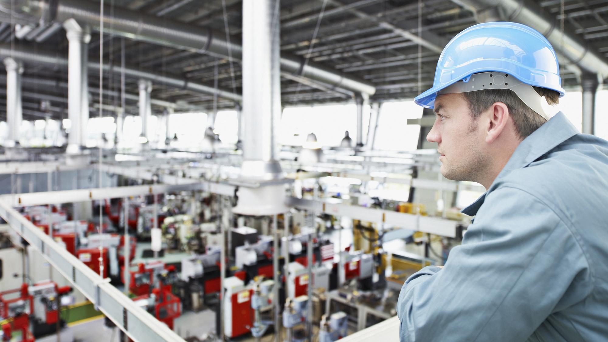 Image of worker overseeing factory work