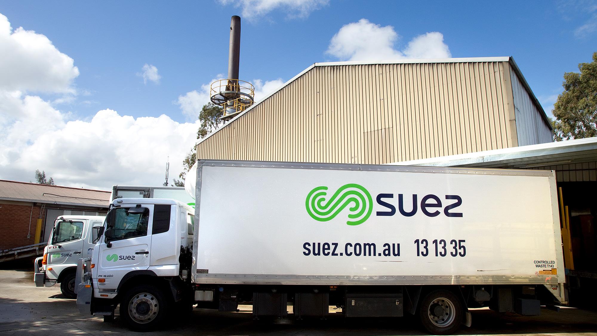 SUEZ Medical Waste Facilities header image. Image of SUEZ medical pantech trucks outside Welshpool Medical Waste Facility, Perth.