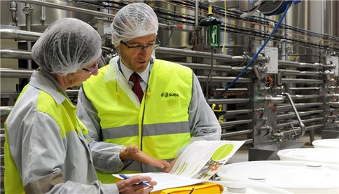 Image showing SUEZ employee conducting on-site waste audit