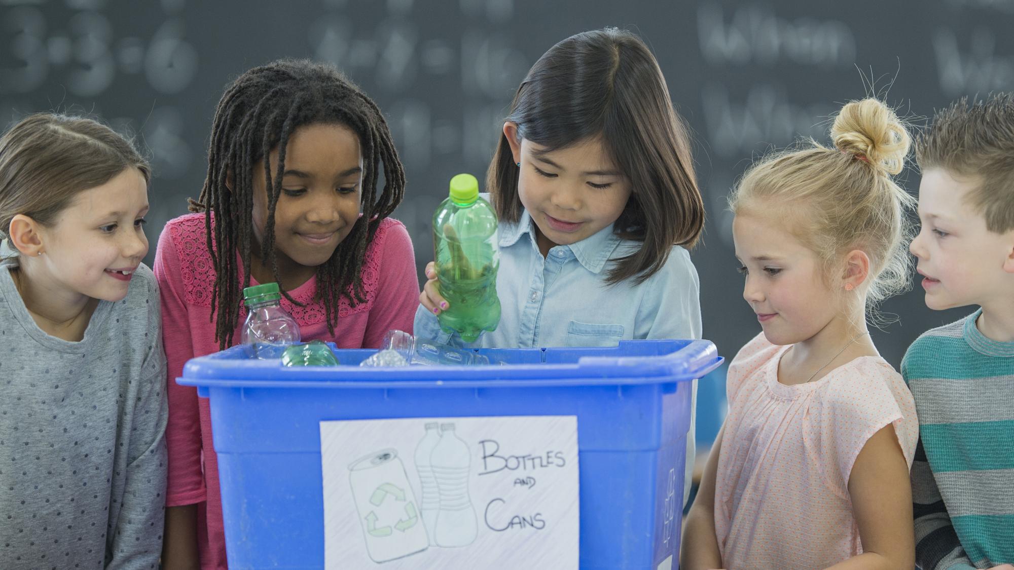 school children sorting recycling