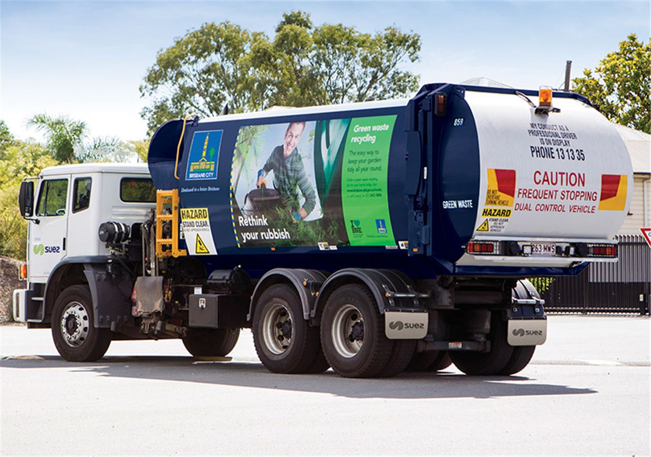 SUEZ truck collecting in suburban streets