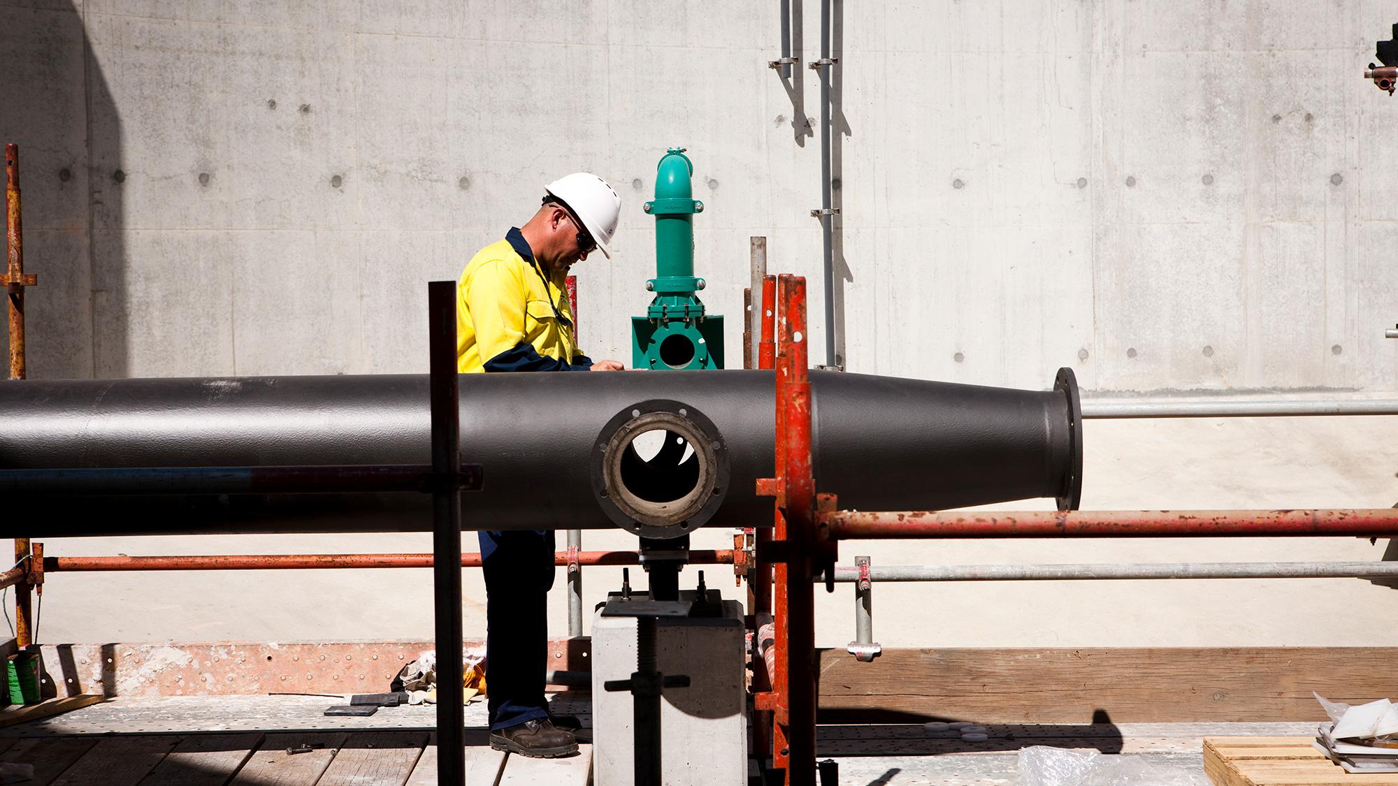 Allwater employee assembling plant