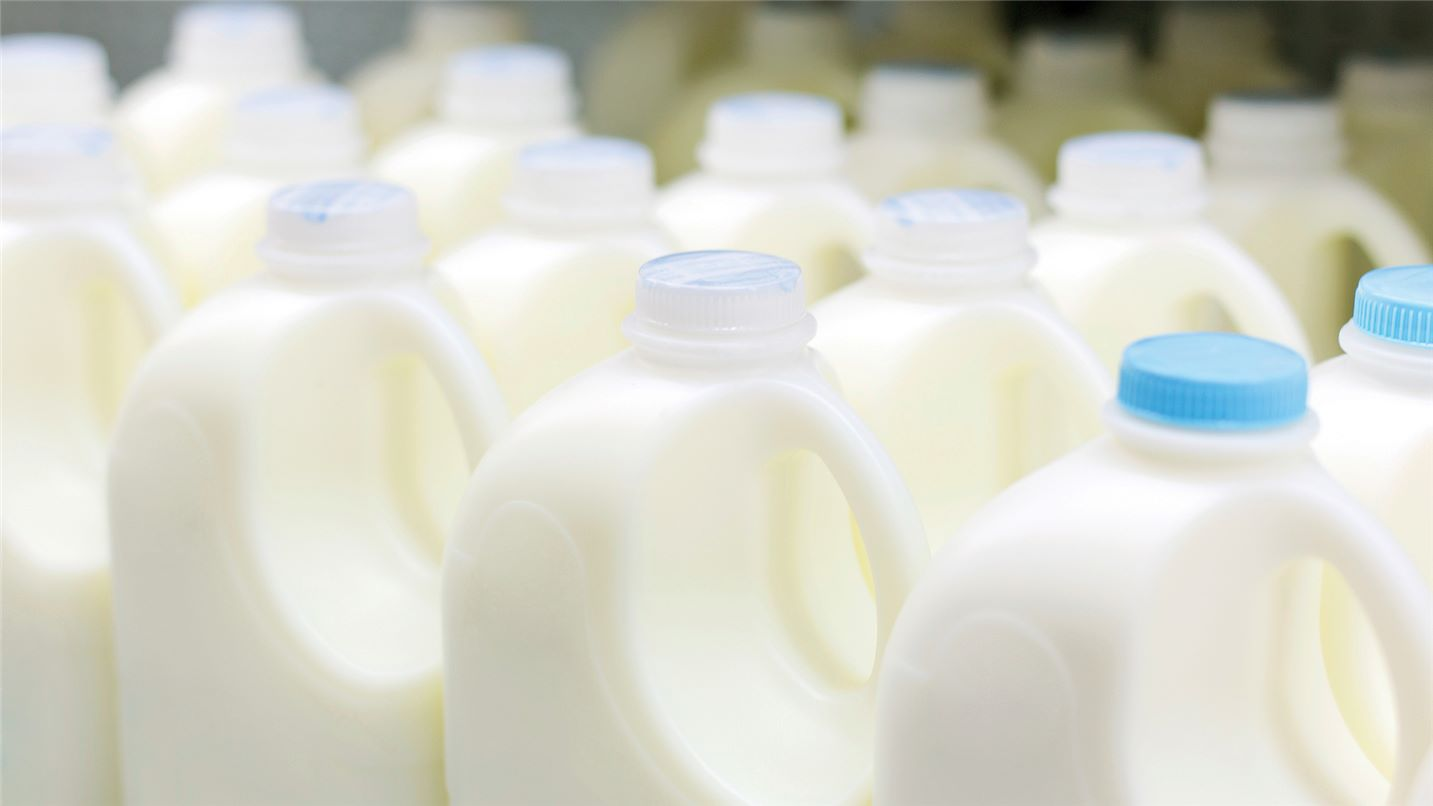 Bottle of milk  ready for depackaging