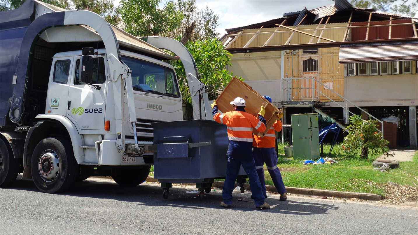SUEZ employees cleaning up after natural disaster