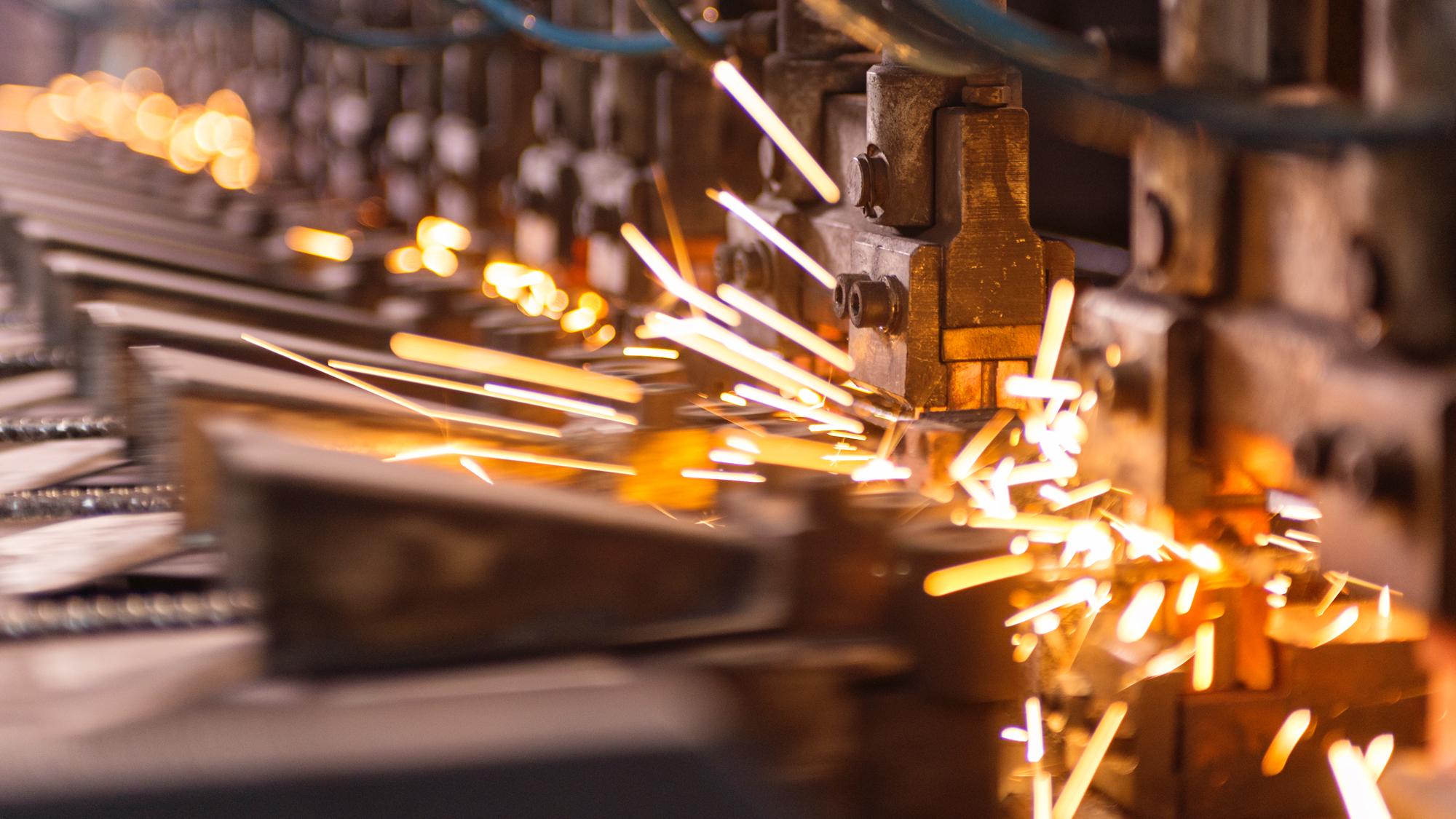 SUEZ manufacturing business image. Spot welding machine. Sparks