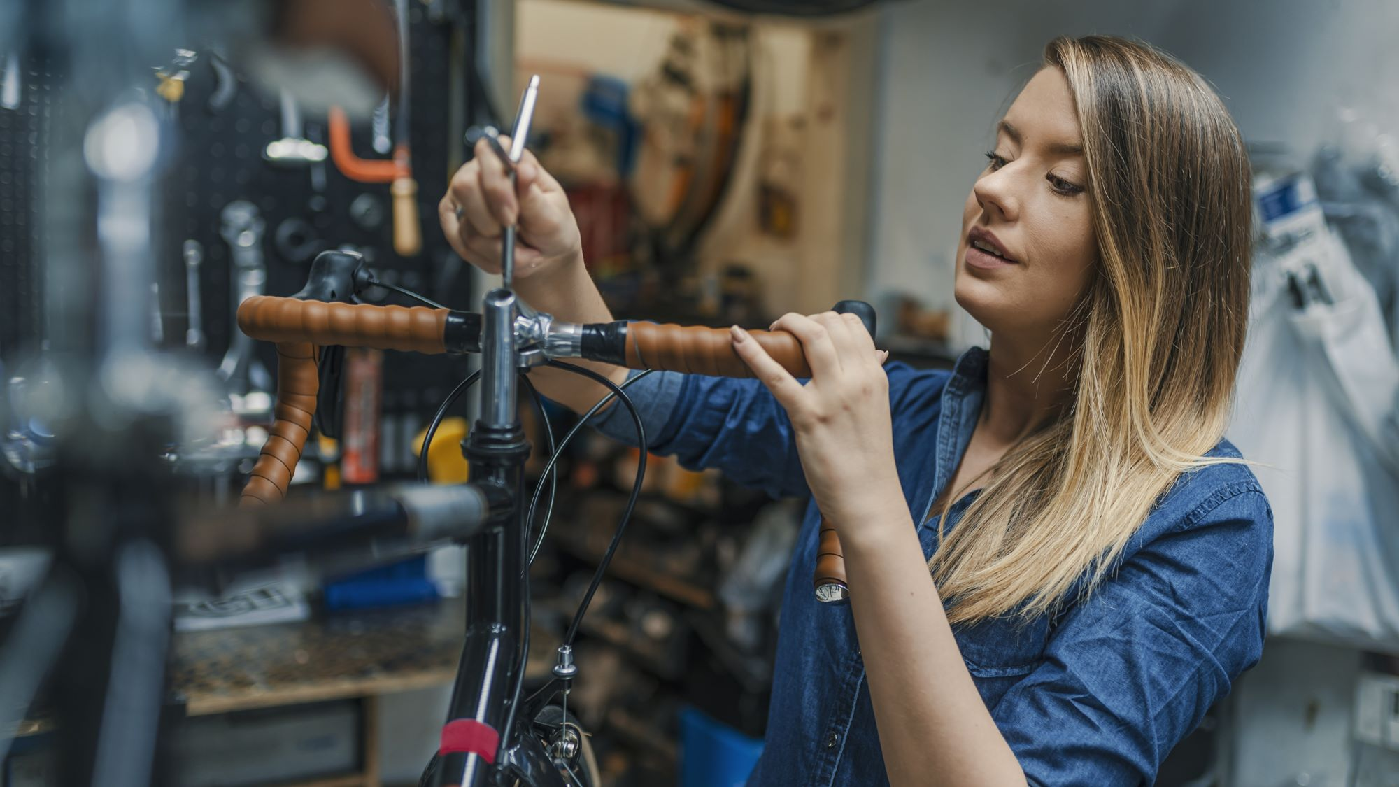 Woman bicycle technician fixing a bike