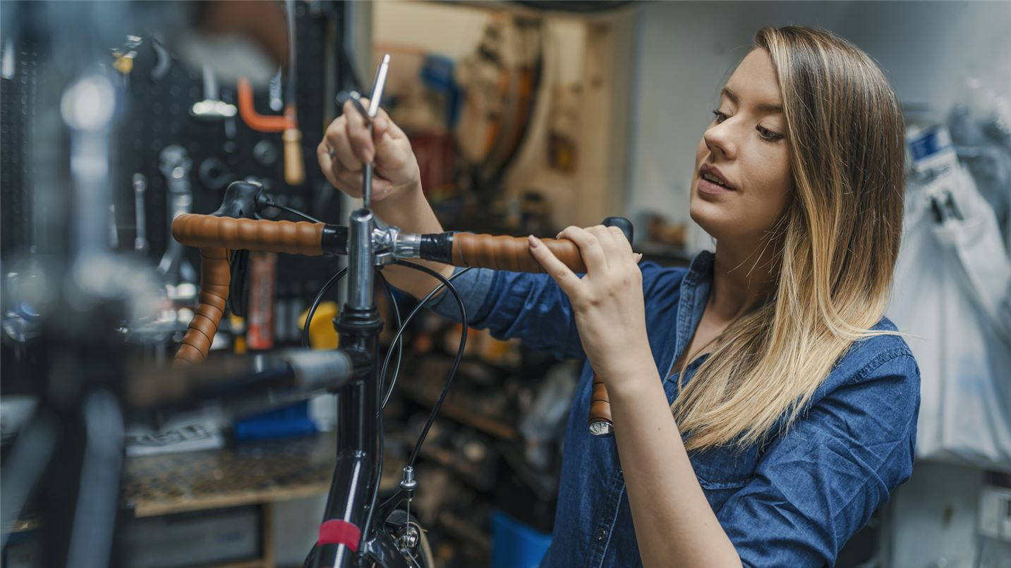 Woman bicycle technician fixing a bike