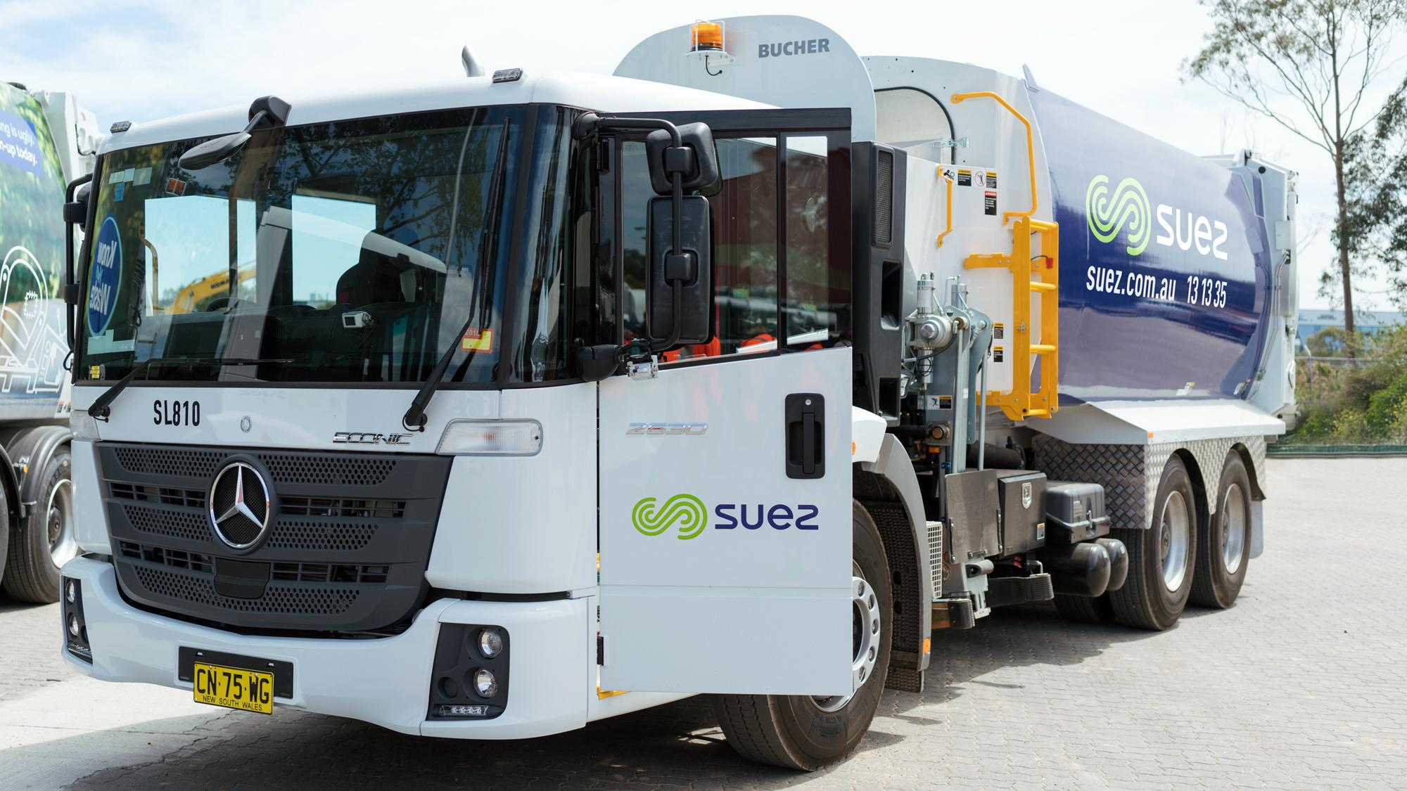 SUEZ waste management equipment image header. Image showing Mercedes side lift garbage truck displaying SUEZ livery.