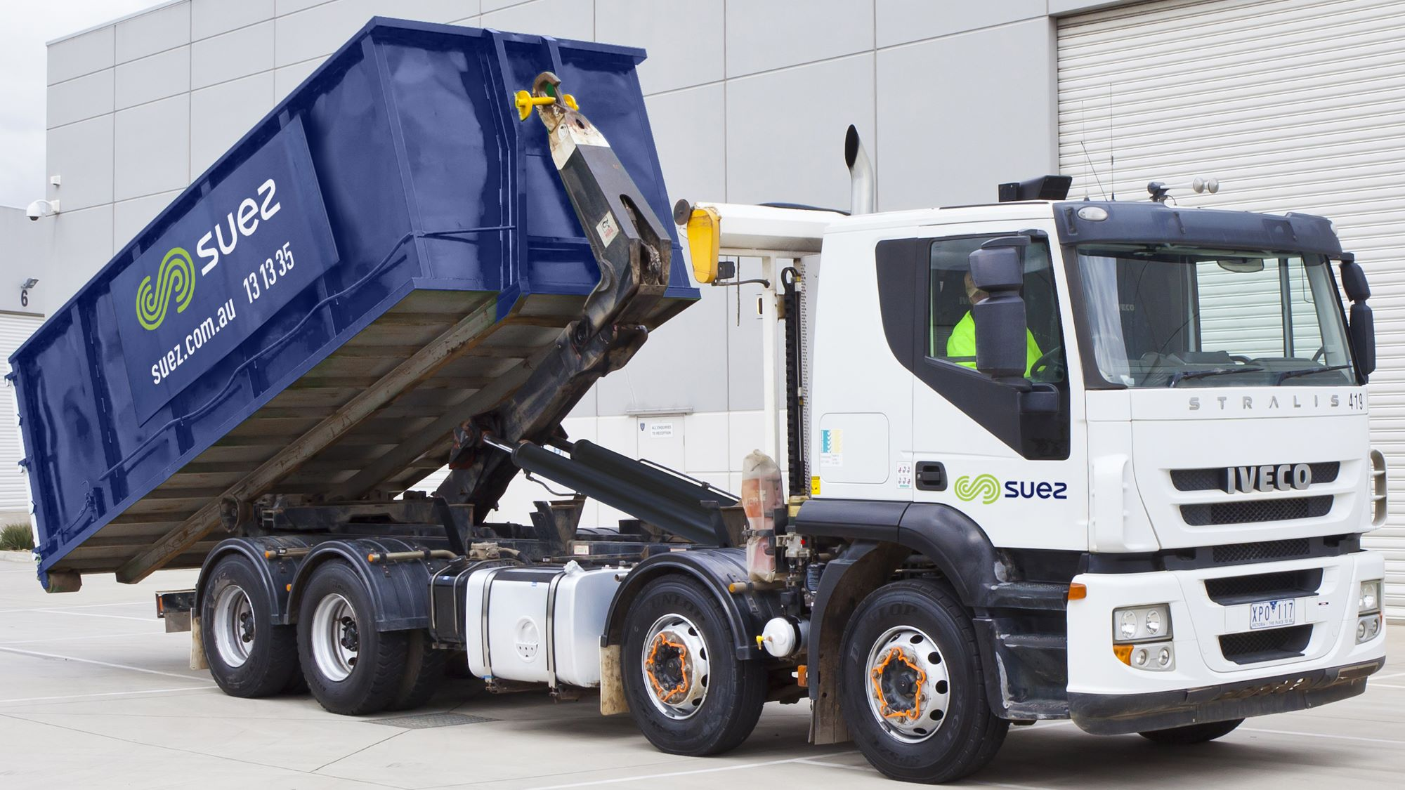 SUEZ skip and RORO bins header image. Image showing SUEZ liveried RORO truck demonstrating how to unload the bin safely.