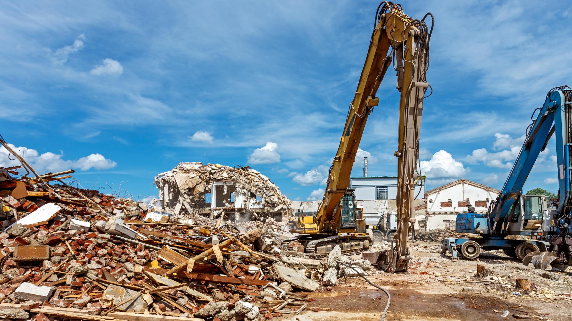 Demolition cranes working on site