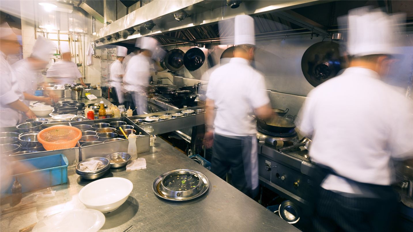 commercial kitchen with chefs at work