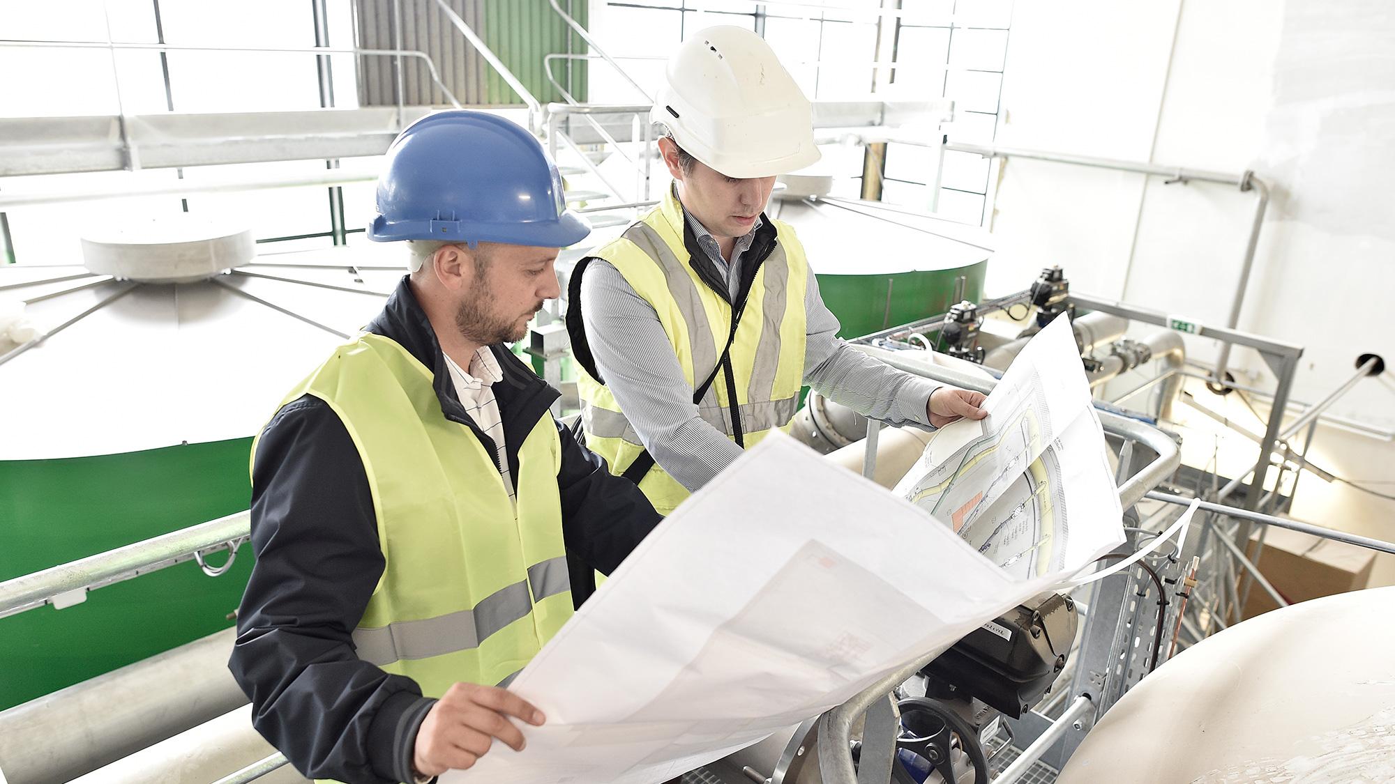 Engineers look over plans