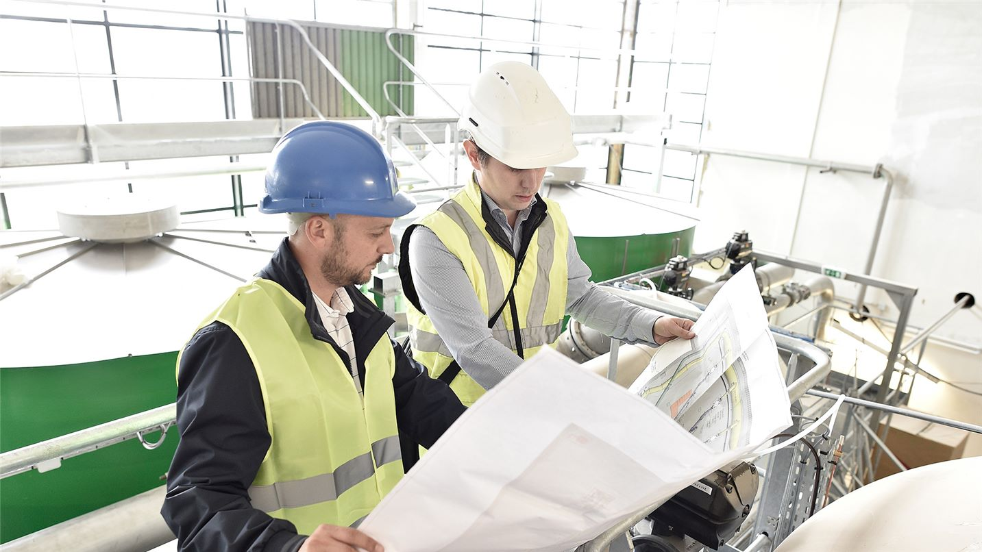 Project partners look over plans