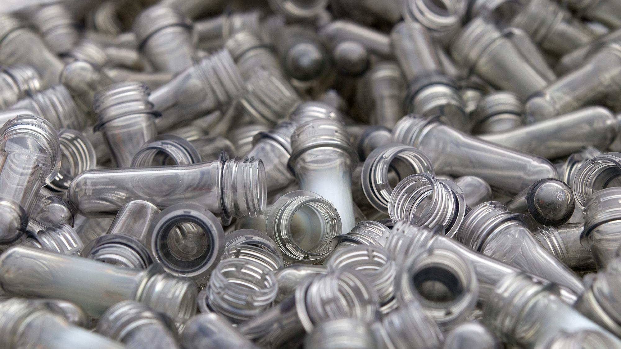 Plastic pre form soft drink bottles