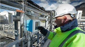 SUEZ employee checking instruments at water plant