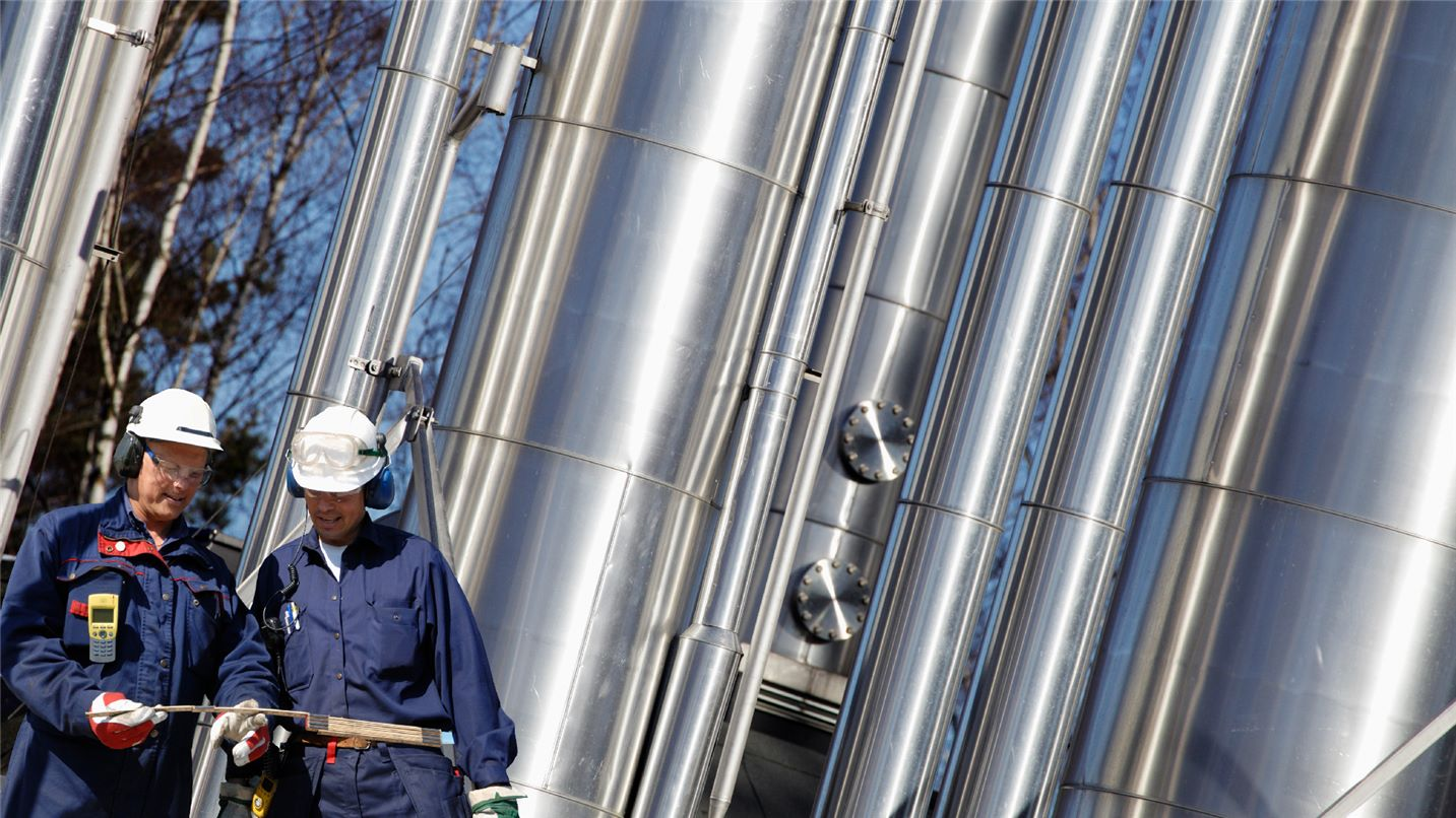 employees at petrochemical refining plant
