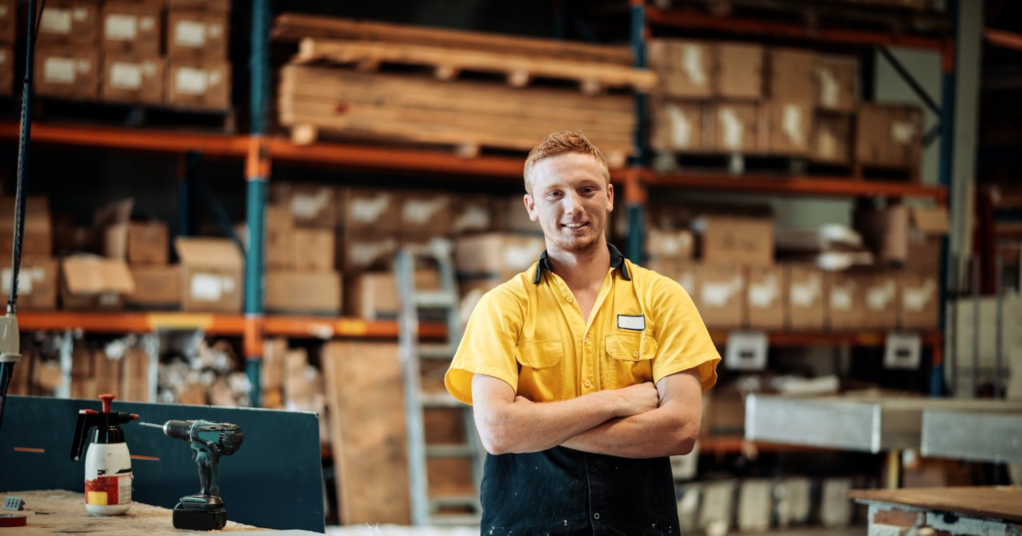 man smiling in a workshop