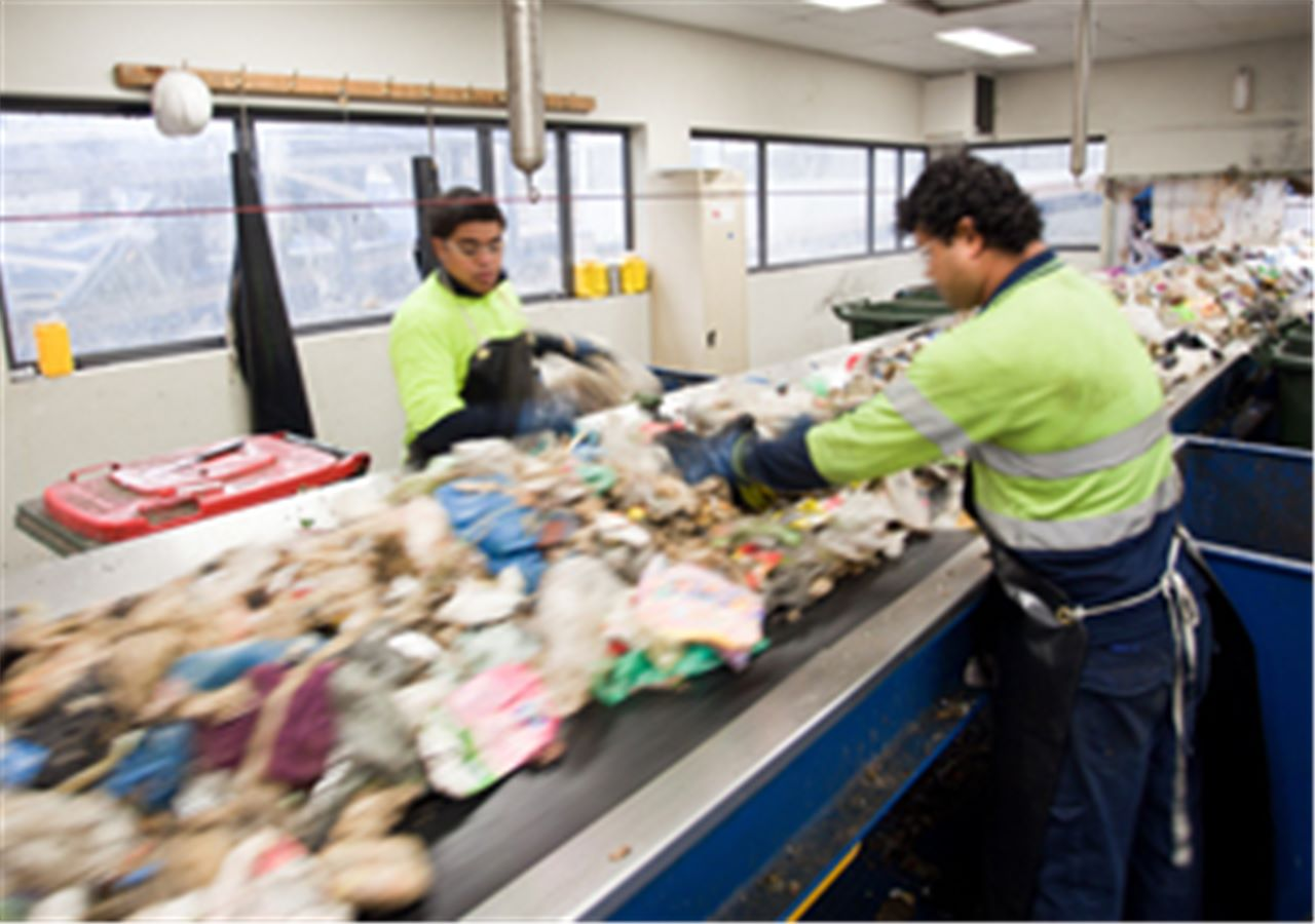 SUEZ employees sorting waste