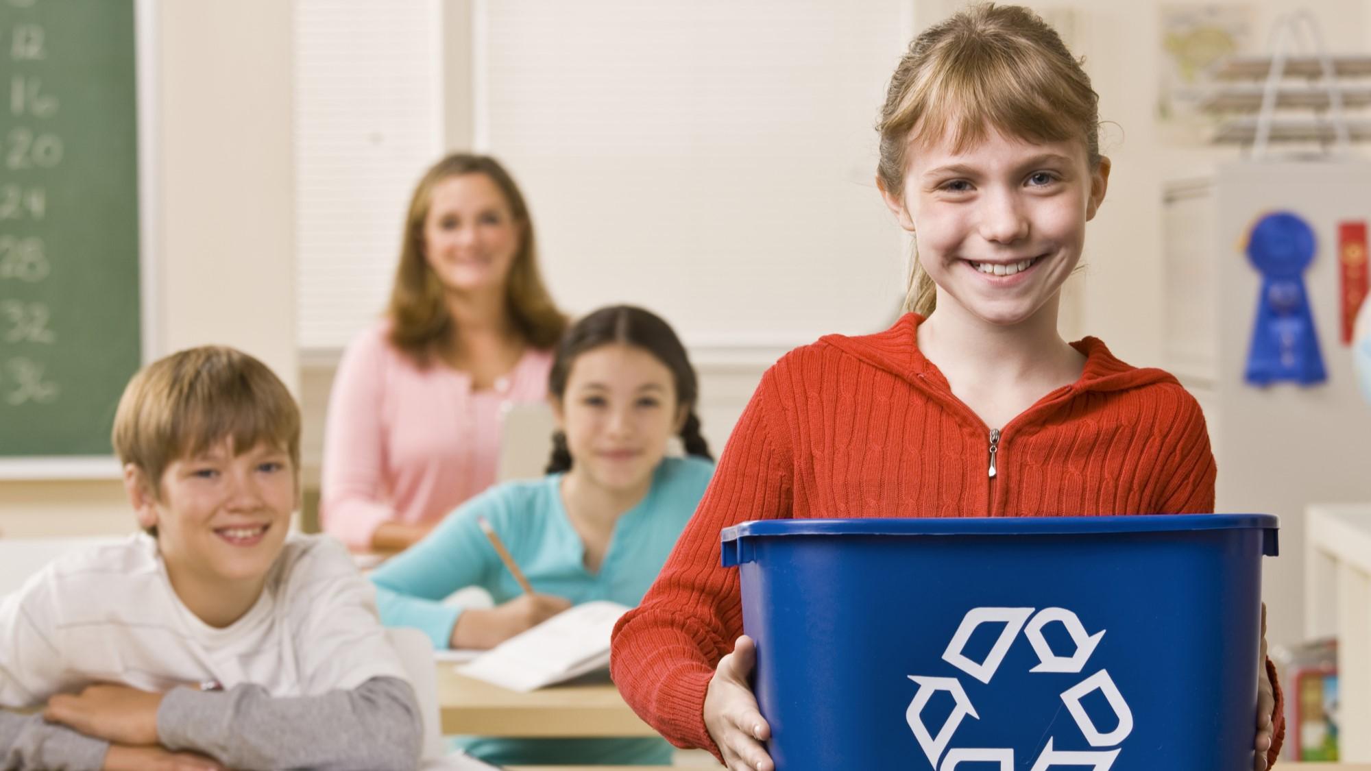SUEZ ANZ news customer survey student carrying recycling bin