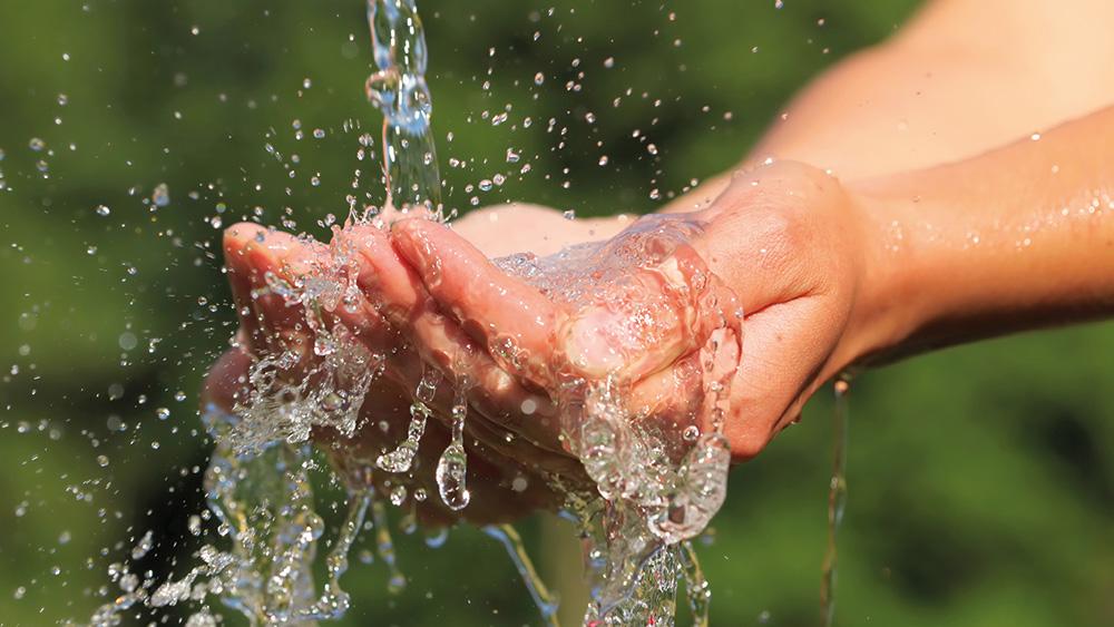 Hands under flowing water