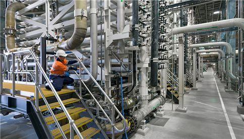 image of SUEZ employee testing water quality at Desal plant