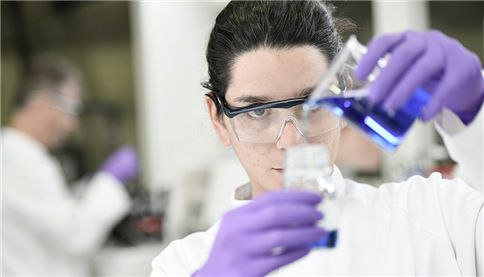 image of lab technician doing tests