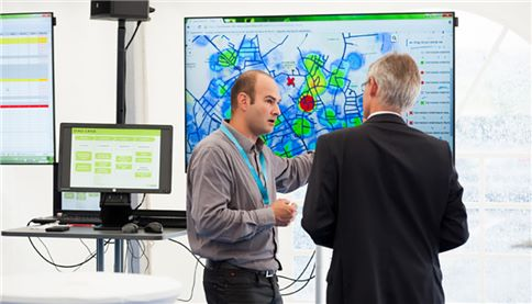 Employees looking at digital map