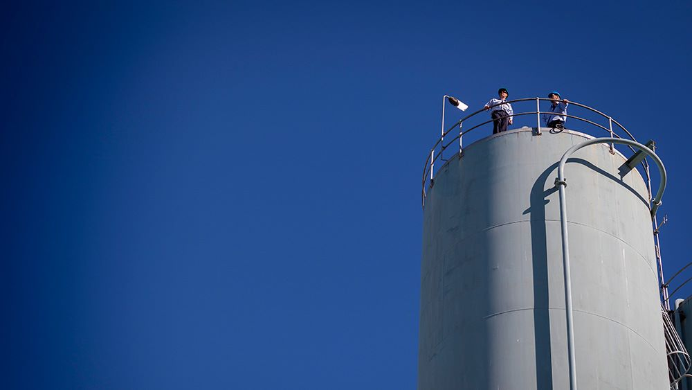 Prospect WTP employees overlooking the plant from top of tank