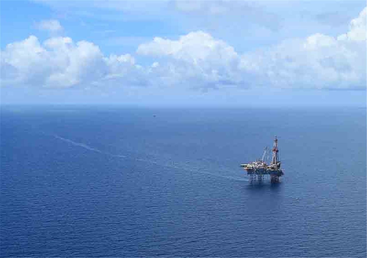 Offshore jack up drilling rig in the middle of the ocean