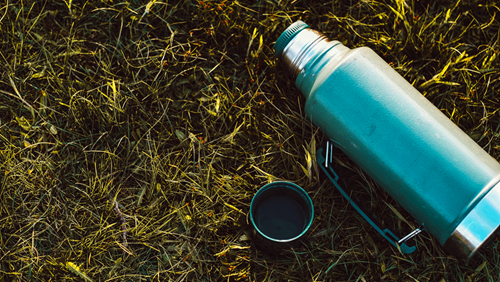 Camping steel thermos with hot tea or coffee
