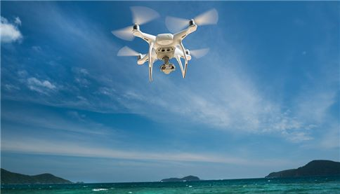 drone flying over sea