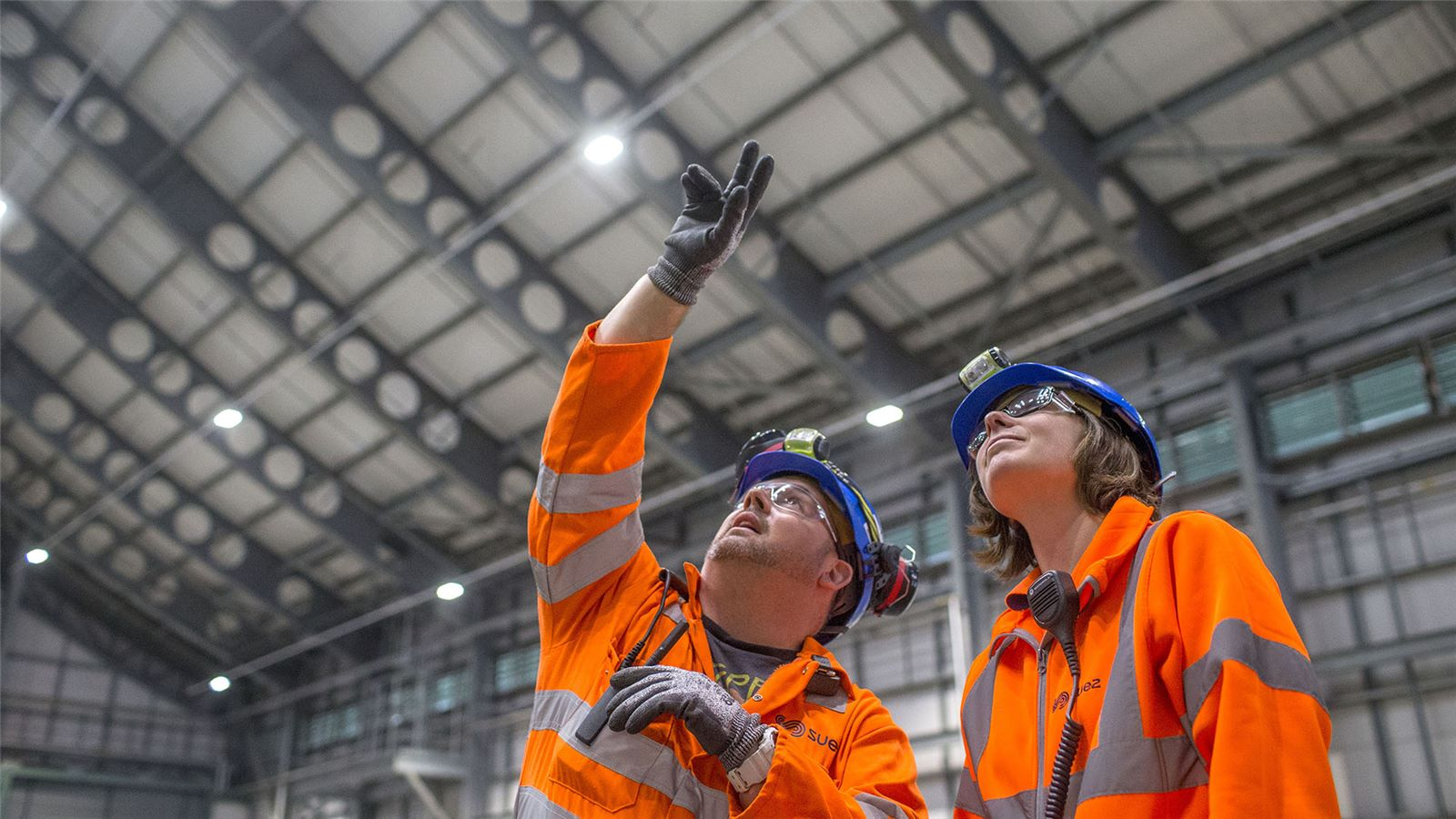Employees looking up inside energy from waste facility