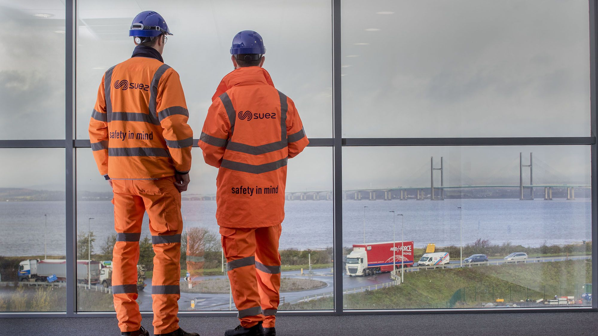 Employees looking out over the River Severn