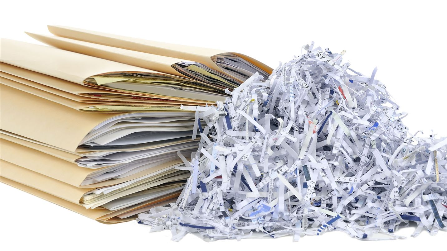 Shredded paper next to paper files