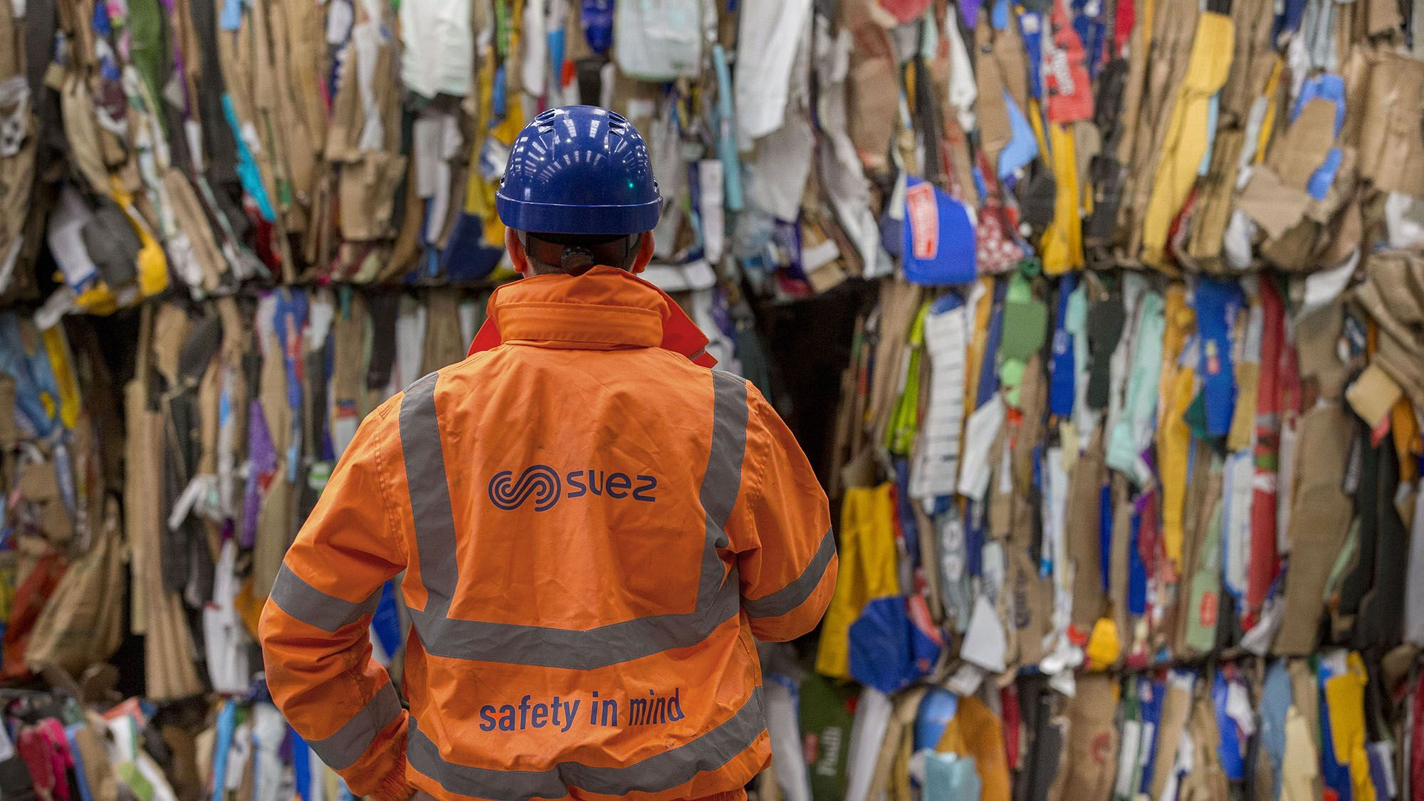 Avonmouth   Employee in front of recycling bales