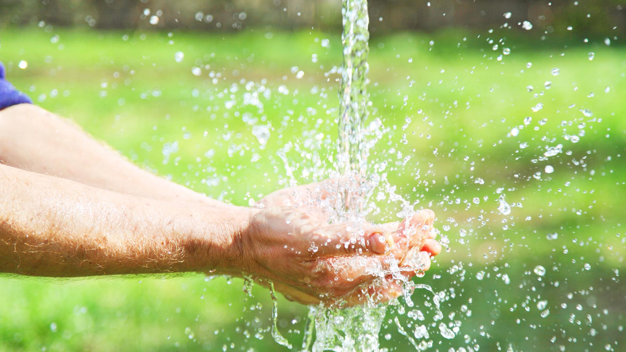 Hands with water splash