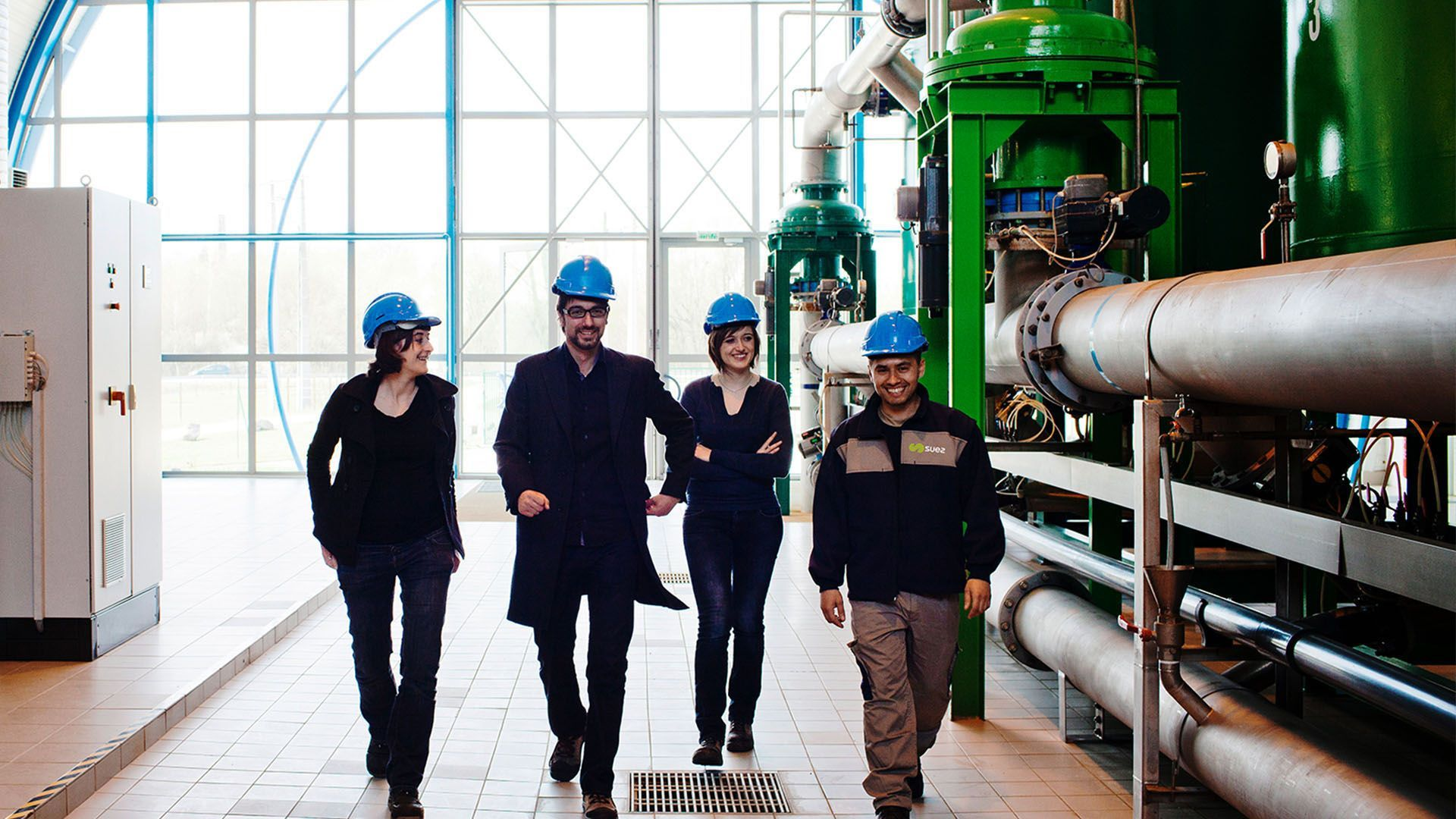Employees walking round facility